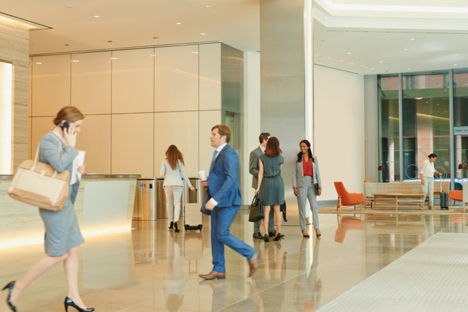 Image of business people doing their thing in a lobby of an office building
